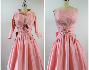 1950s Pink Dress Fit and Flare Matching Cropped Jacket Large Bow Size XS Boat Neck Full Skirt Tea Length Prom Dress by Sophisticated Miss