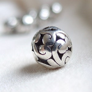 11mm wide x 9mm hole diameter 5mm package of 6 6 Silver scroll pattern with Black Antiquing large hole beads