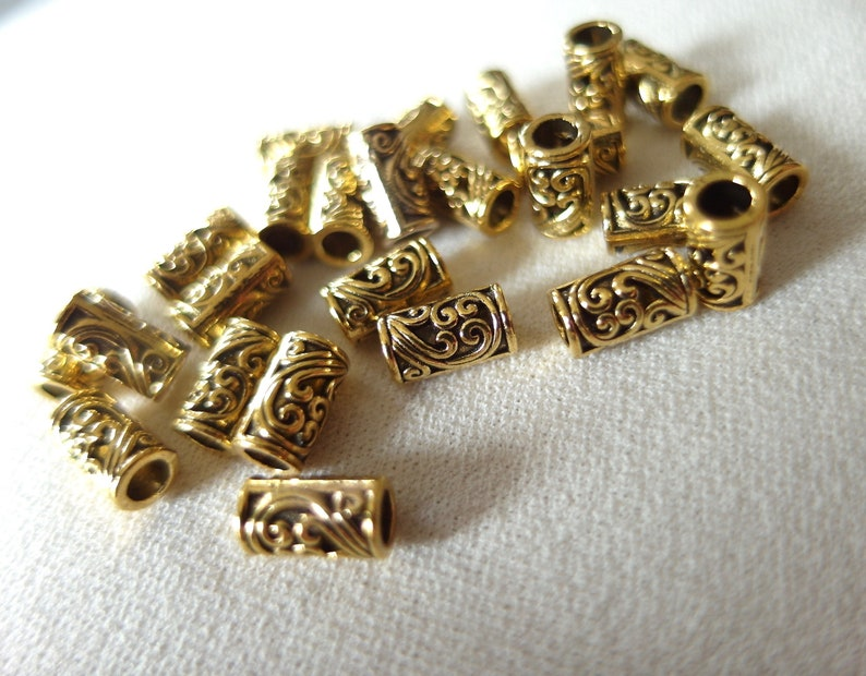 3mm hole pkg 25 25 gold plated scroll pattern tube beads 9mm long x 4mm wide