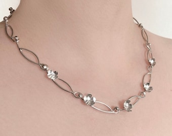 Daisy Chain collar necklace. Made to Order.  Hand made from sterling silver sheet and wire.