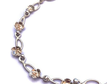 Daisy Chain bracelet Made to Order  from sterling silver wire and sheet. Shown here with rose gold stamens.