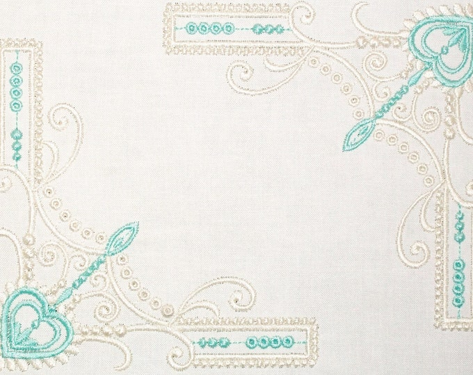 Delicate scrollwork corner motifs embroidered quilt label to customize with your personal message