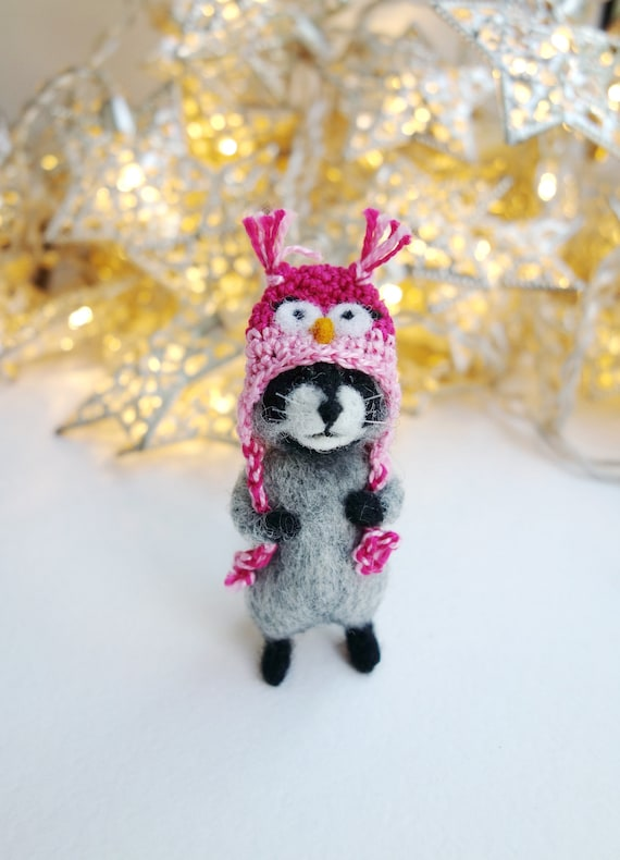 Miniature needle felted raccoon in a crochet owl hat