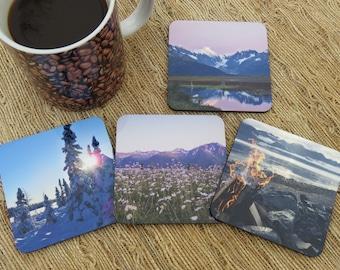 Alaskan Scenery 4pc Coaster Set - Winter Wonderland, Mountain Sunset, Field of Daisies, Rocky Beach Campfire