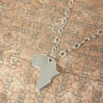 Africa Map Pendant Tiny Africa Necklace Silver Map Pendant Africa Necklace Africa Map Charm in a kraft gift box wiht an Extra Free Gift