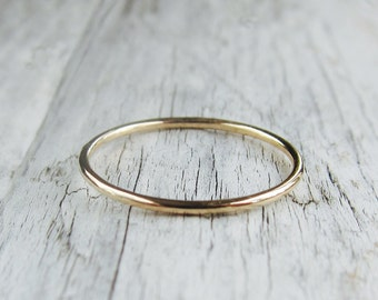 14k gold band. Plain solid gold ring. Thin, skinny, smooth wedding band. Minimalist jewelry.