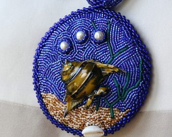 Bubbles Vintage Fish Pin Necklace in blue, sand, and Pearl