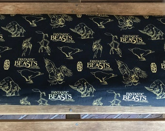Fantastic Beasts / Black Logo and Creatures With Metallics  - Camelot Fabrics - Wizarding World - 23900102L