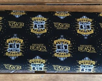 Fantastic Beasts / Black Logo and Suitcase With Metallics  - Camelot Fabrics - Wizarding World - 23900101