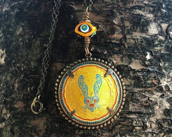 I Spy a Rabbit Upcycled Rabbit Beer Cap Set in Brass Pendant with Eye Shaped Colorful Glass Bead