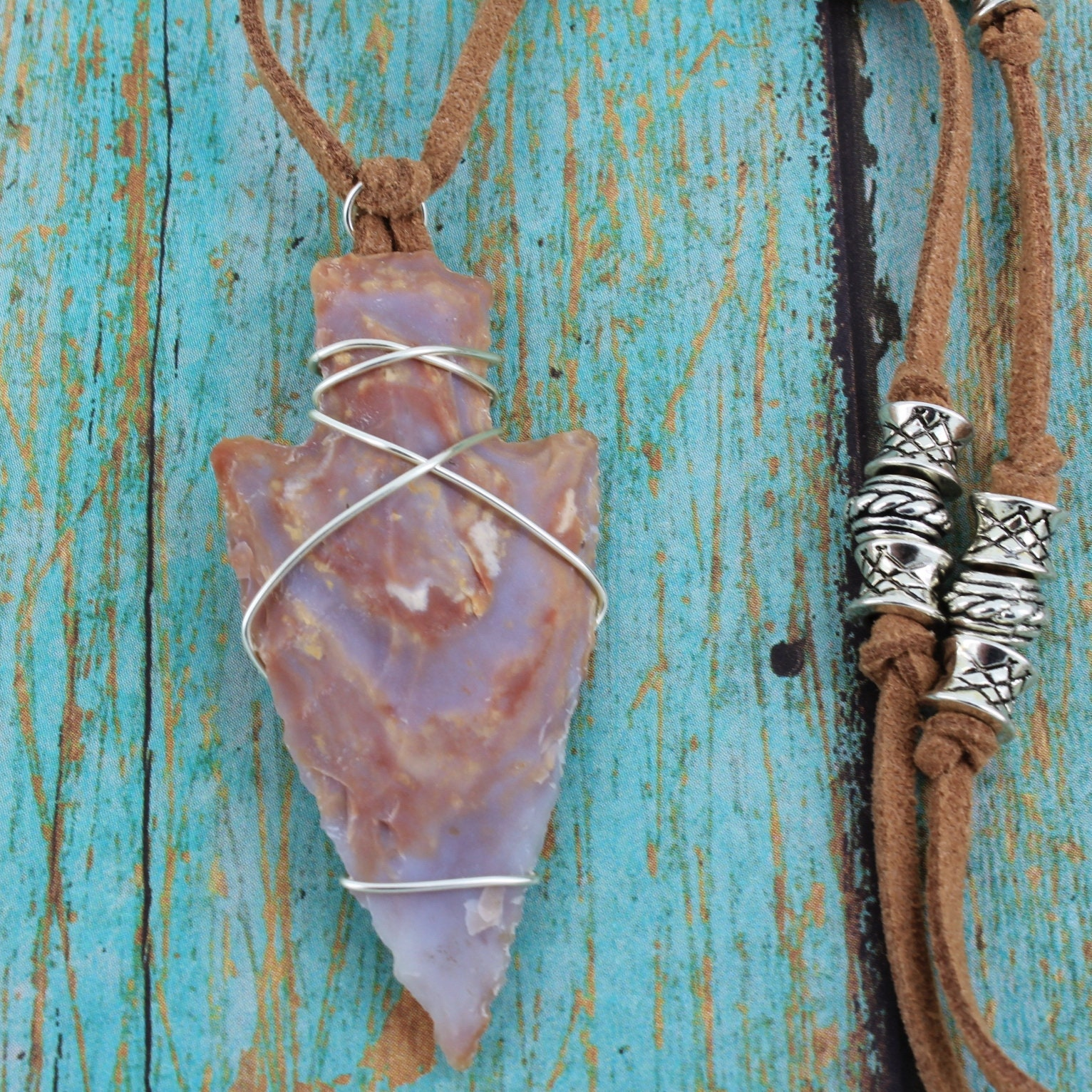 Silver,Wrapped,Arrowhead,with,Tan,Suede,Cord,Necklace,Jewelry,knapped_jasper,primitive_style,unisex_necklace,arrowhead_necklace,mens_necklace,wired_arrowhead,Native_American,wirewrapped,locally_sourced,one_of_a_kind,blue_and_rust,silver_wirewrap,suede_cord,Stone