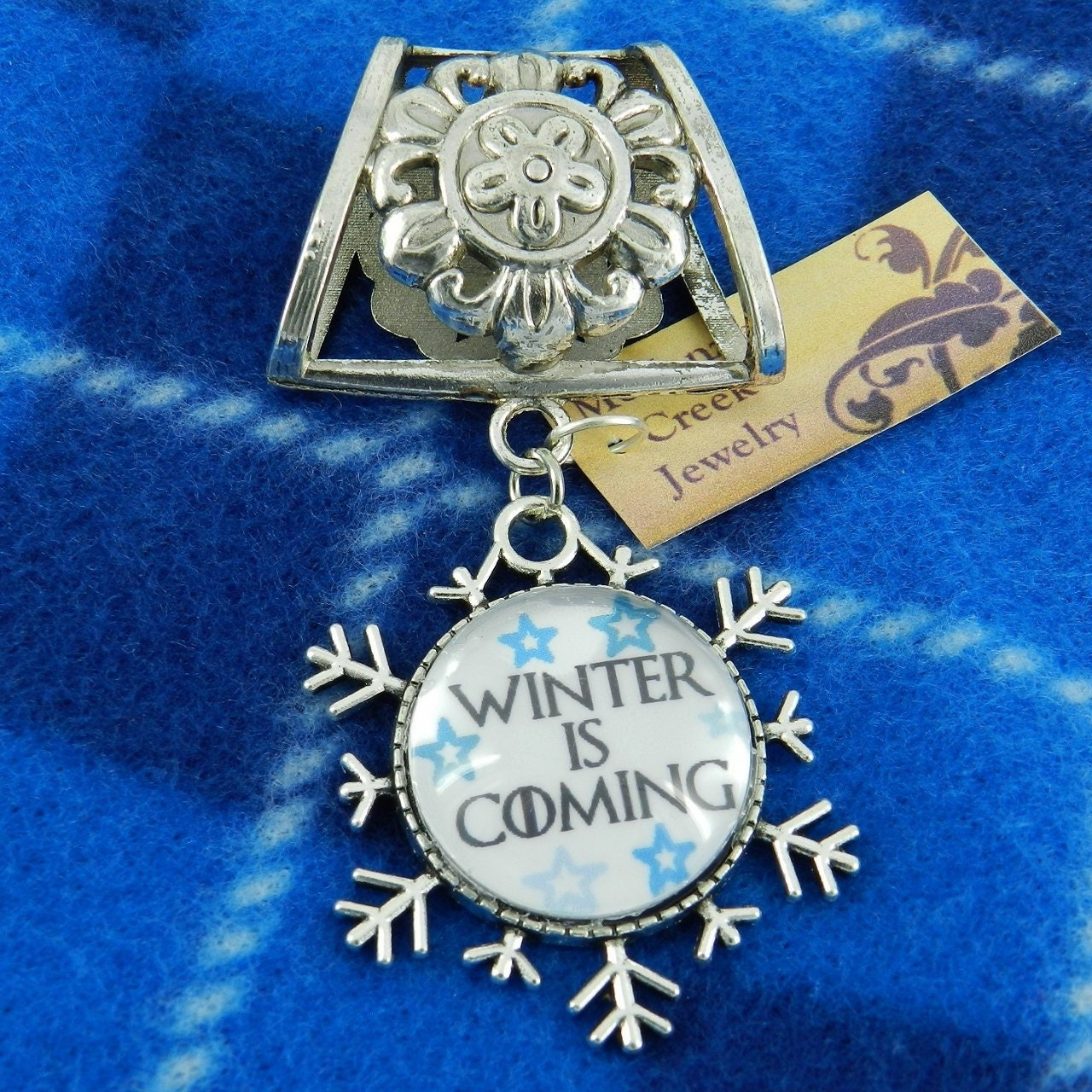 Winter,Is,Coming,Scarf,Pendant,~,Game,of,Thrones,Jewelry,Accessory~,Charm,Slide,Accessories,scarf_charm,scarf_accessory,scarf_pendant,scarf_jewelry,scarf_slide,scarf_bling,Game_of_Thrones,Winter_is_Coming,Winter_jewelry,snowflake_jewelry,blue_snowflakes,winter_accessory,Jon_Snow,Snowflake setting,Glass cabochon,Silver alloy sli