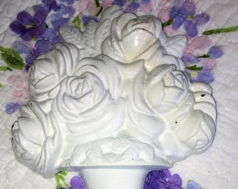 Vintage Cast Iron Door Stop with White Roses Design