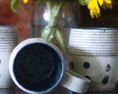 Stoneware, Black polkadot mug.