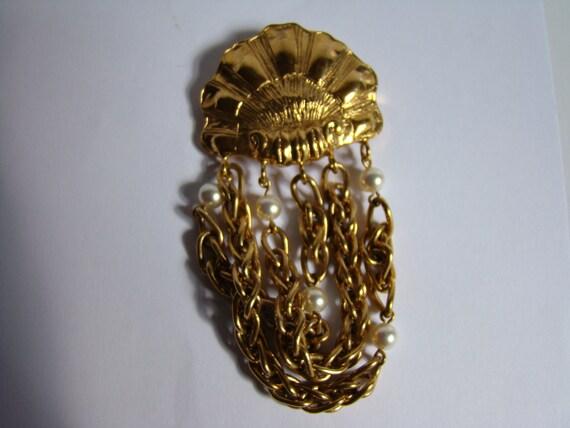 Rochas brooch