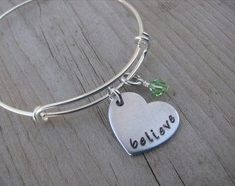 "Believe Bracelet- Heart- Hand-stamped to say, ""believe "" with an accent bead in your choice of colors"
