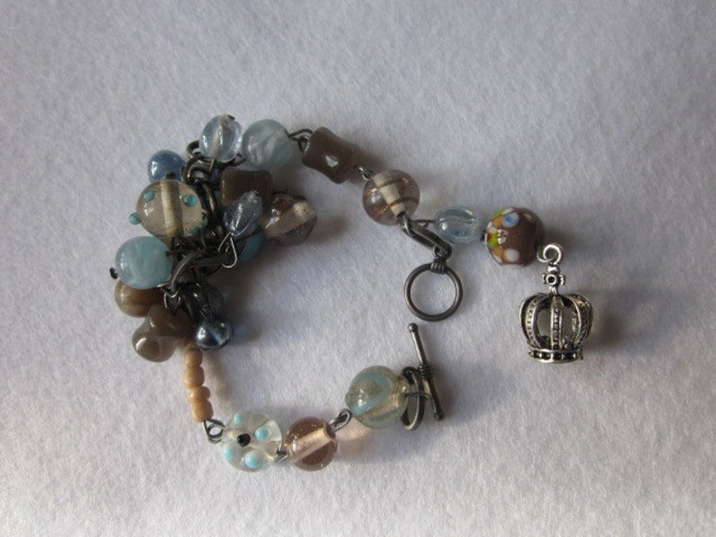 Silver Metal Bracelet with a mix of Pastel Colored Czech Glass Beads and a Tibetan Silver Crown Charm