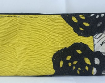 RivAgo clutch in yellow leather