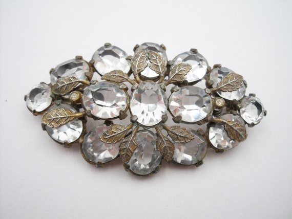 Thirties large oval clear stone brooch with leaf d