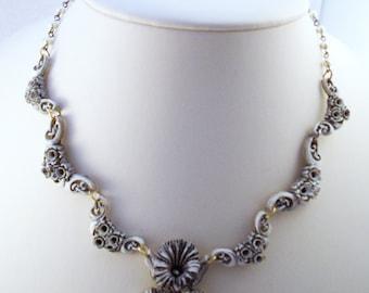 Feather lite Celluloid flower necklace Iris necklace