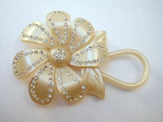Luminous celluloid rhinestone studded flower brooc
