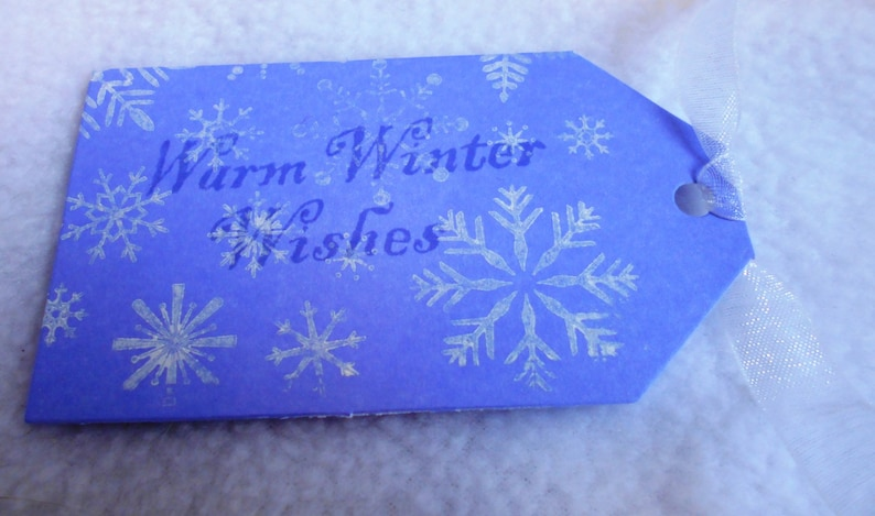 Hand stamped Warm Winter Wishes snowflake gift tags Snowflake gift tags Set of 3 gift tags in blue and white with matching ribbon purple