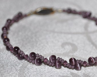 Purple Bracelet made with Cat's Eyes, Swarovski Crystals, Seed Beads, and an Antique Gold Clasp