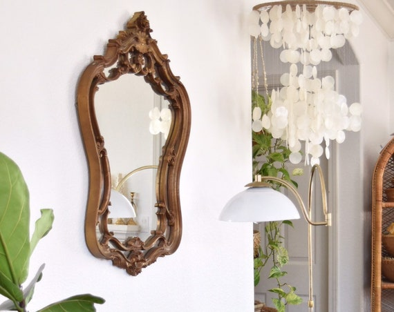 large gold ornate faux wood wall hanging mirror