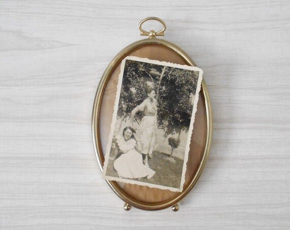 small standing vintage brass oval shaped convex picture frame