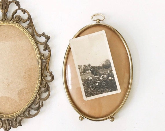 small standing vintage brass oval shaped convex picture frame with hanging knob