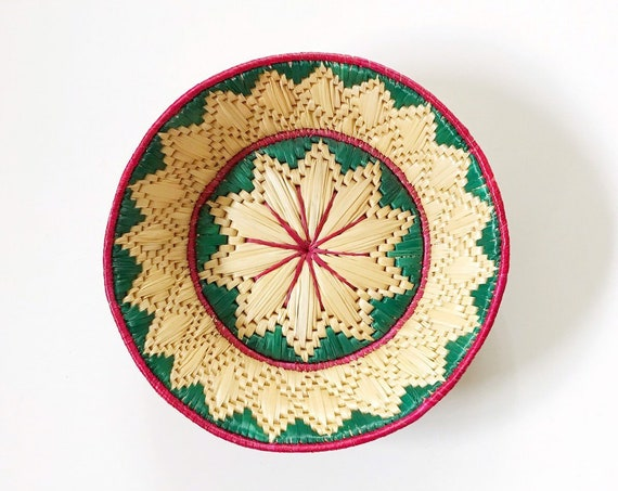 green southwestern woven straw wall hanging basket with flower pattern / star poinsettias