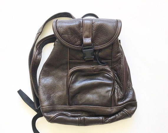 vintage real leather dark brown small sling backpack purse / adjustable straps / carry on travel bag