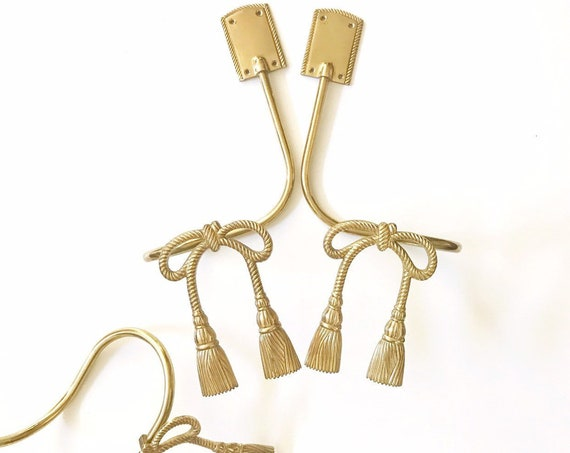 set of 2 hollywood regency solid brass tassel bow tie back / curtain holder pair