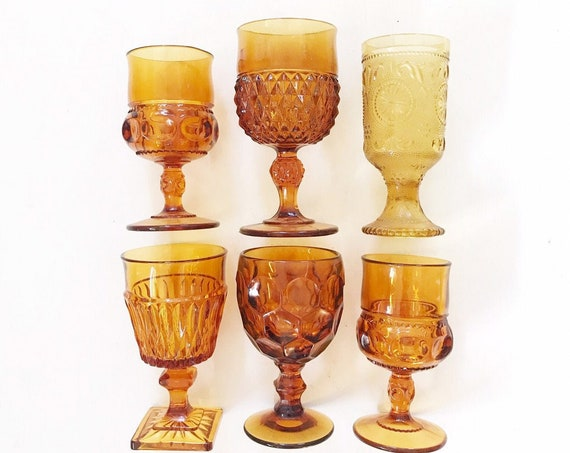large mix collection of amber glass champagne wine glass goblets / depression glass set