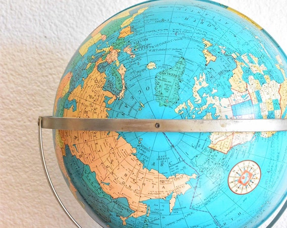 solid metal 12 inch mid century modern ohio art company world globe / blue