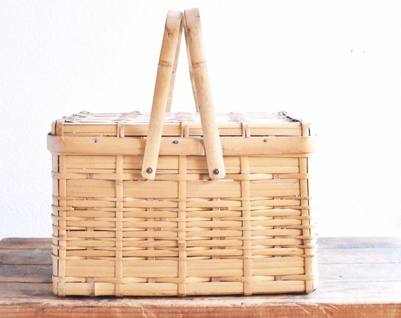 carrying mid century woven bamboo rattan picnic basket with handle and lid | storage basket
