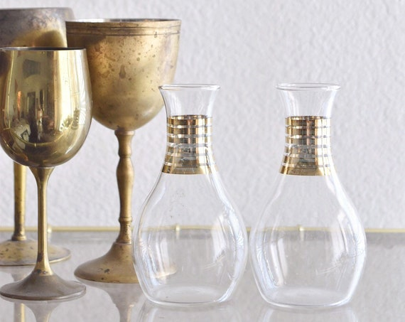 hollywood regency set of clear glass bottle flower vases with gold trim | bud vase propagating station