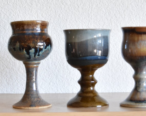 set of brown blue stoneware ceramic pottery goblets / collection