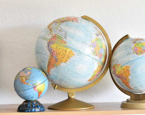 "12"" multicolored vintage replogle world globe / raised relief atlas"
