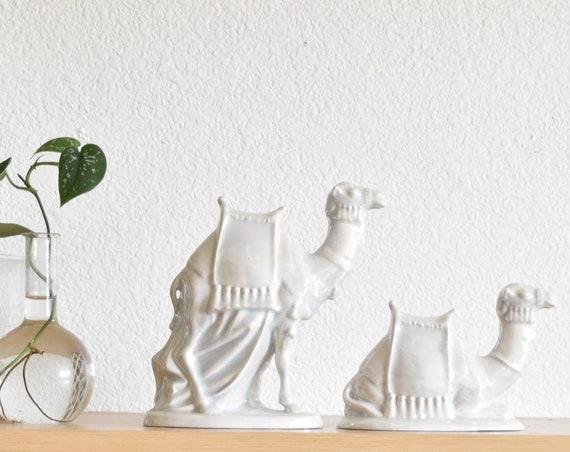 pair of vintage porcelain iridescent white camel figurine sculpture   set of 2