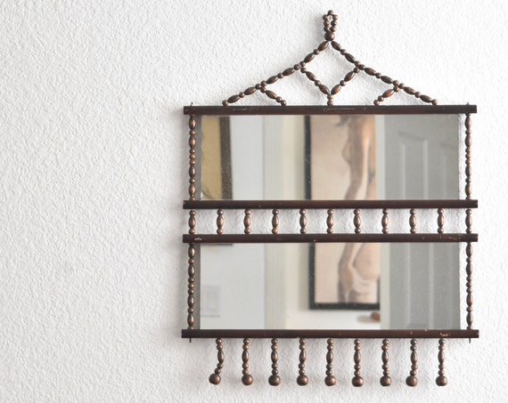 vintage mid century ornate wood beaded hanging wall mirror