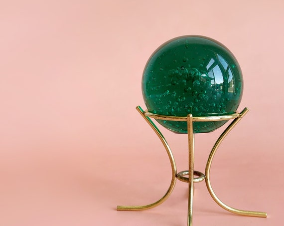 green glass ball globe office paperweight on a gold metal stand