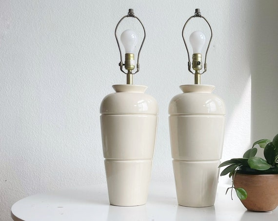 large 1980s revival off white ceramic table lamps with brass metal accent | set of 2