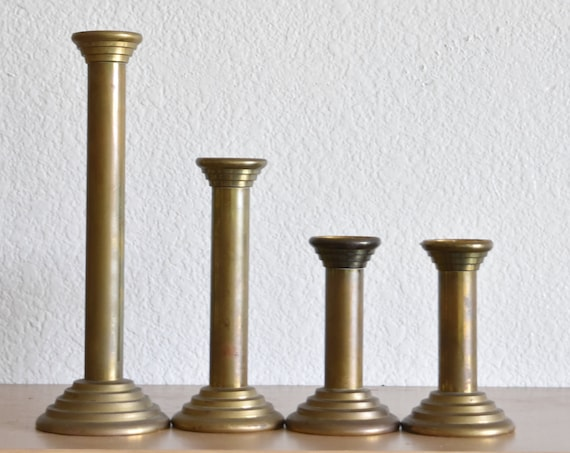 set of art deco solid brass candlestick holders