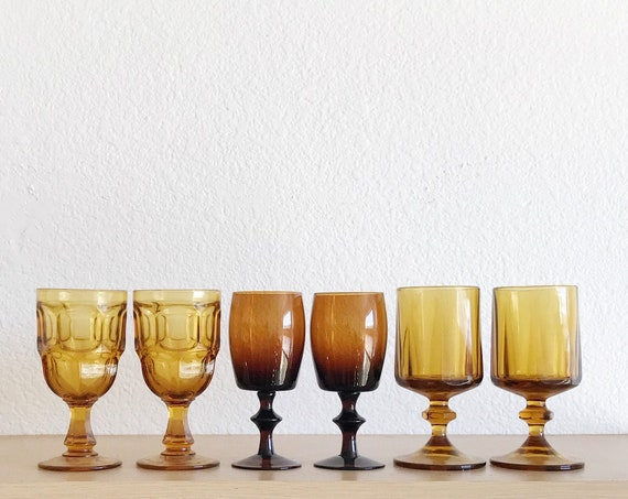 mix collection of brown and amber glass champagne wine glass goblets / depression glass set