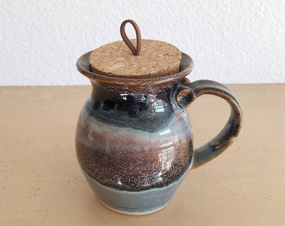 hand thrown earth tone pottery stoneware coffee mug with cork lid