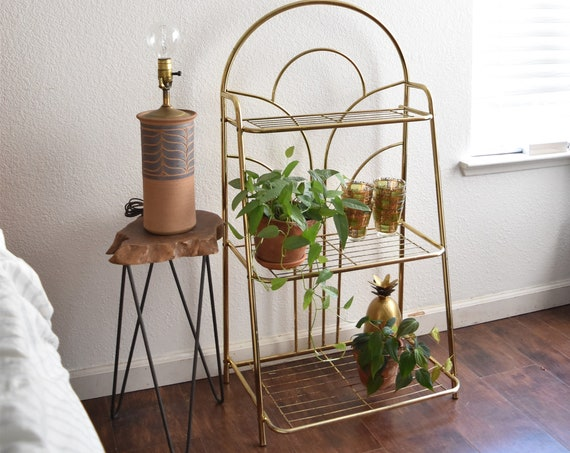 mid century modern gold tone magazine file plant stand | hollywood regency tiered shelf