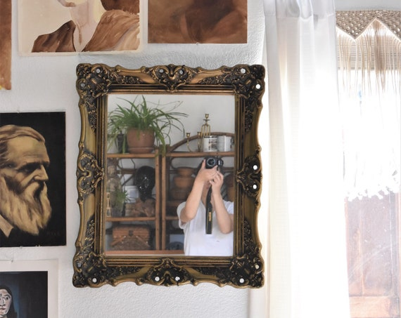 large gold ornate faux brass wall hanging mirror