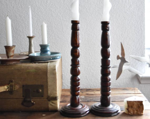 pair of tall rustic wood brass candle holders
