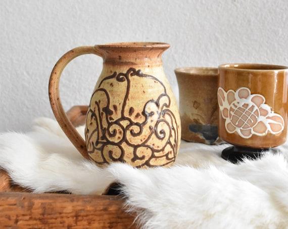 large brown hand thrown stoneware pottery mug / floral